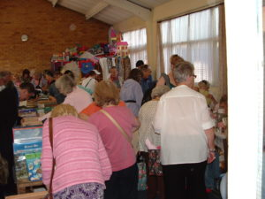 A busy table top sale in aid of Cat and Kitten Care
