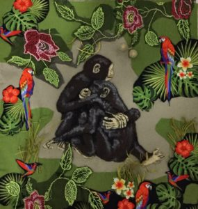 Chocolate and Chimpanzees, a textile panel by Dorothy Jerrome, shows a female chimp comforting a male who has just lost a fight. This image symbolises other losses, such as the profound one of habitat loss caused by the destruction of rainforests for the purpose of growing cocoa.